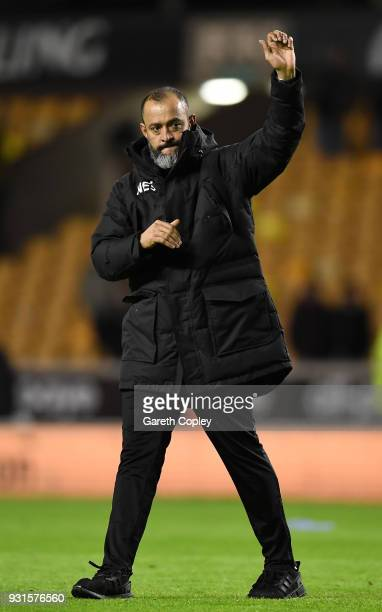 Nuno Espirito Santo of Wolverhampton Wanderers wave to the fans after victory in the Sky Bet Championship match between Wolverhampton Wanderers and...