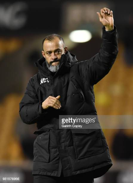 Nuno Espirito Santo of Wolverhampton Wanderers waves to the fans after victory in the Sky Bet Championship match between Wolverhampton Wanderers and...