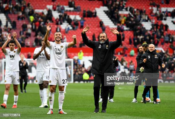 Nuno Espirito Santo the head coach / manager of Wolverhampton Wanderers celebrates a draw with the travelling fans during the Premier League match...