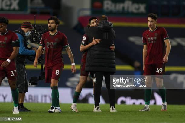 Nuno Espirito Santo the head coach / manager of Wolverhampton Wanderers congratulates Raul Jimenez after the 01 victory in the Premier League match...