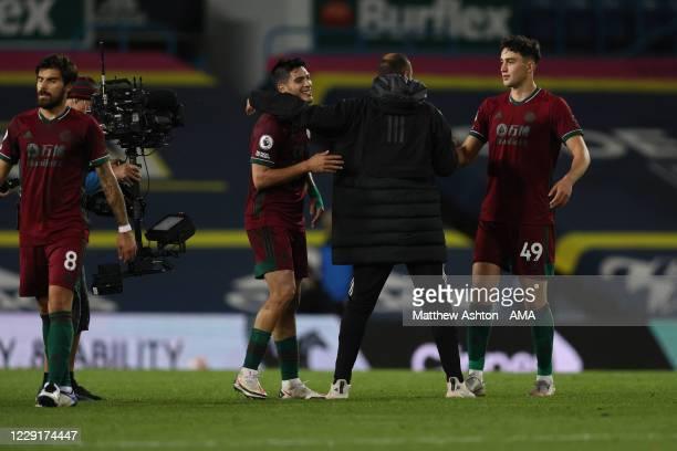 Nuno Espirito Santo the head coach / manager of Wolverhampton Wanderers congratulates Raul Jimenez and Max Kilman after the 01 victory in the Premier...