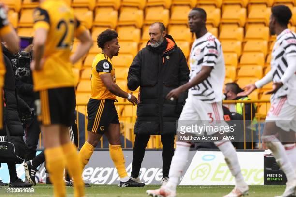 Nuno Espirito Santo the head coach / manager of Wolverhampton Wanderers consoles Adama Traore of Wolverhampton Wanderers as he goes off injured...