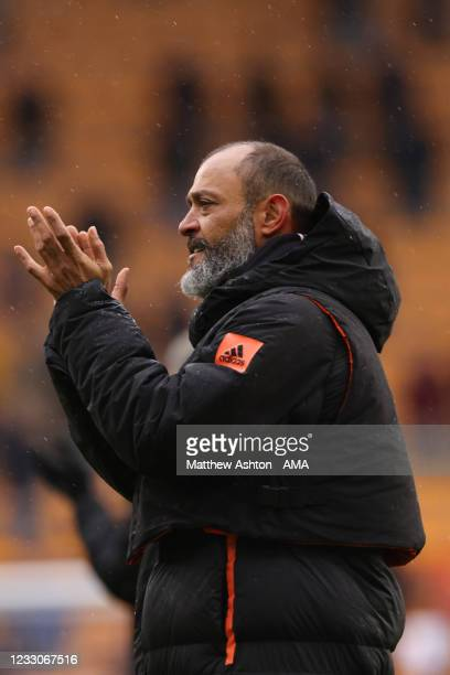 Nuno Espirito Santo the head coach / manager of Wolverhampton Wanderers applauds the fans at full time on his final game in charge of the team during...