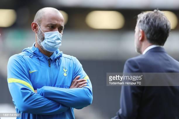 Nuno Espirito Santo, Tottenham Hotspur manager talks to Managing Director of Football, Fabio Paratici prior to the Pre-Season Friendly match between...
