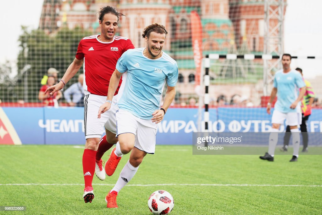 Nuno Gomes (L) competes with Diego Forlan during the Legends Football Match in 'The park of Soccer and rest' at Red Square on July 11, 2018 in Moscow, Russia.