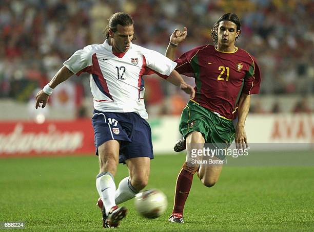 Nuno Gomes of Portugal and Jeff Agoos of USA in action during the second half during the Portugal v USA Group D World Cup Group Stage match played at...