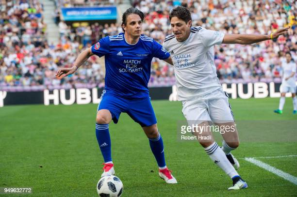 Nuno Gomes vies with Edmilson during the UEFA Match for Solidarity at Stade de Geneva on April 21 2018 in Geneva Switzerland