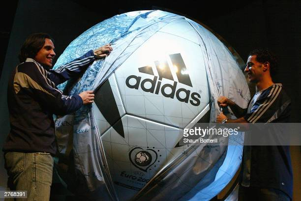 Nuno Gomez and Sabrosa Simao of Portugal reveal the Euro 2004 Adidas Roteiro Ball during the official ball launch for the Euro 2004 Chamionships at...