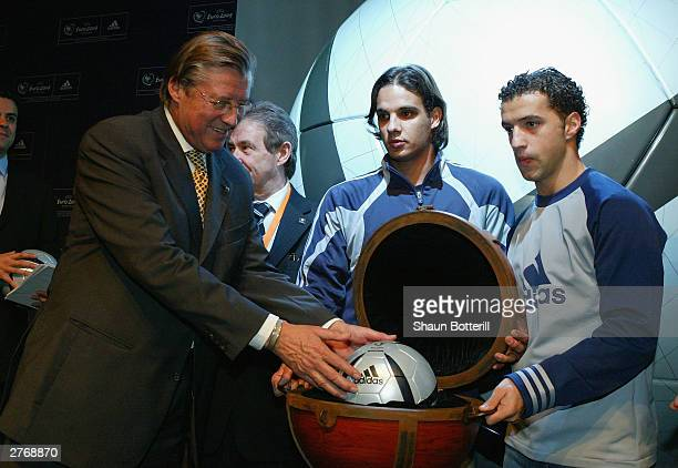 Nuno Gomez and Sabrosa Simao of Portugal watch as Gerhard Aigner UEFA CEO receives the Euro 2004 Roteiro Ball during the Adidas Rotiero Ball Launch...