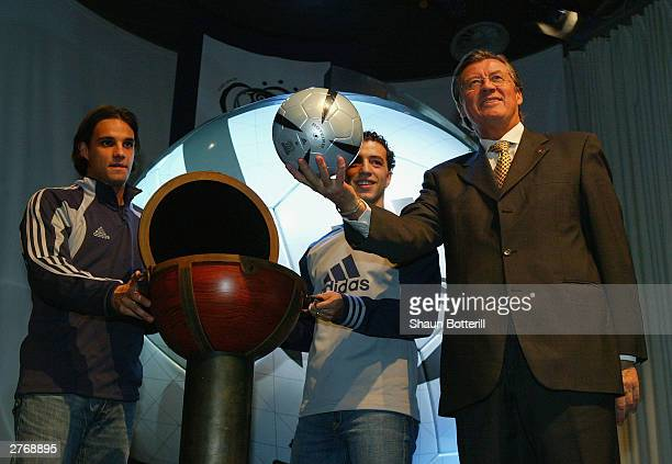 Nuno Gomez and Sabrosa Simao of Portugal watch as Gerhard Aigner UEFA CEO holds up the Euro 2004 Roteiro Ball during the Adidas Rotiero Ball Launch...