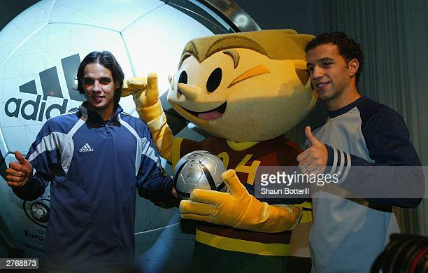 Nuno Gomez and Sabrosa Simao of Portugal with Ninas the official Euro 2004 mascot and the Euro 2004 Roteiro Ball during the Adidas Rotiero Ball...