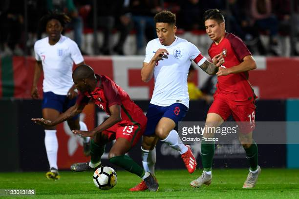 Nuno Henrique of Portugal competes for the ball with Marcus Tavernier of England during the International Friendly match between Portugal U20 and...