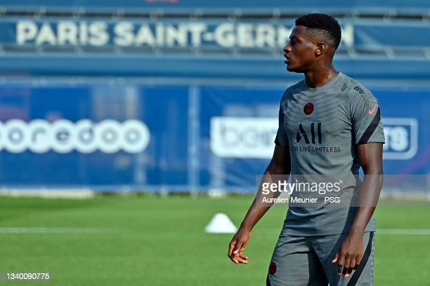 Nuno Mendes looks on during a Paris Saint Germain training session at Ooredoo Center on September 13, 2021 in Paris, France.