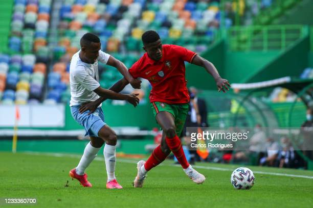 Nuno Mendes of Portugal and Sporting CP vies with Yonas Malede of Israel and Gent for the ball possession during the international friendly match...