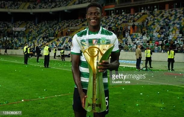 Nuno Mendes of Sporting CP celebrates winning the Portuguese SuperCup with trophy at the end of the Portuguese SuperCup match between Sporting CP and...