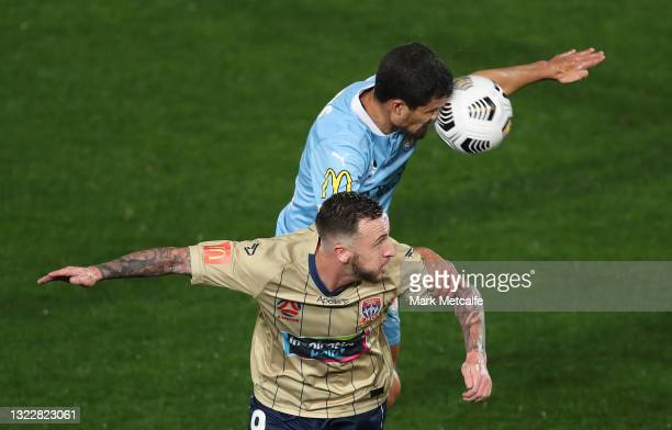 Nuno Reis of Melbourne City heads the ball over Roy O'Donovan of the Jets during the A-League match between Melbourne City and Newcastle Jets at...