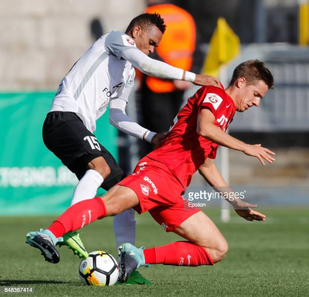 Nuno Rocha of FC Tosno and Mario Pasalic of FC Spartak Moscow vie for the ball during the Russian Football League match between FC Tosno and FC...