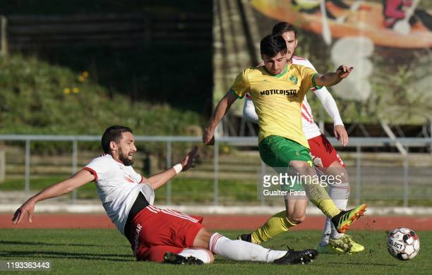 Nuno Rodrigues of CD Mafra with Kassio of UD Vilafranquense in action during the Liga Pro match between CD Mafra and UD Vilafranquense at Estadio do...
