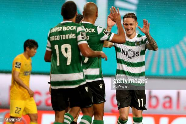 Nuno Santos of Sporting CP celebrates with teammates after scoring during the Portuguese League football match between Sporting CP and Portimonense...