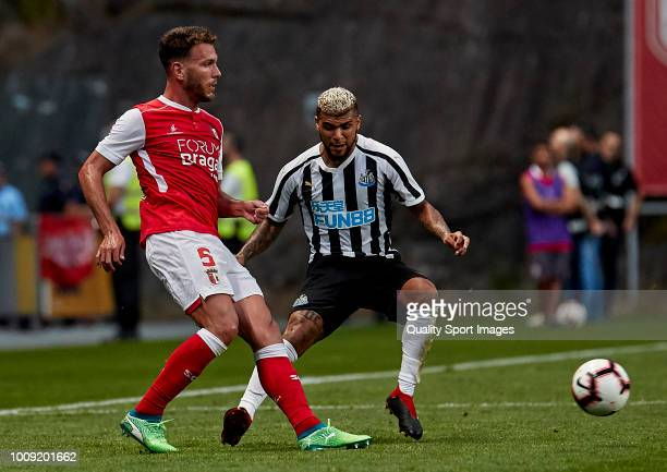 Nuno Sequeira of SC Braga is challenged by DeAndre Yedlin of Newcastle United during the Preseason friendly match between SC Braga and Newcastle...