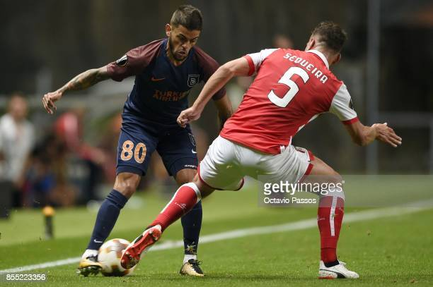 Nuno Sequeira of Sporting Braga competes for the ball with Junior Caicara of Basaksehir F.K. During the UEFA Europa League group C match between...