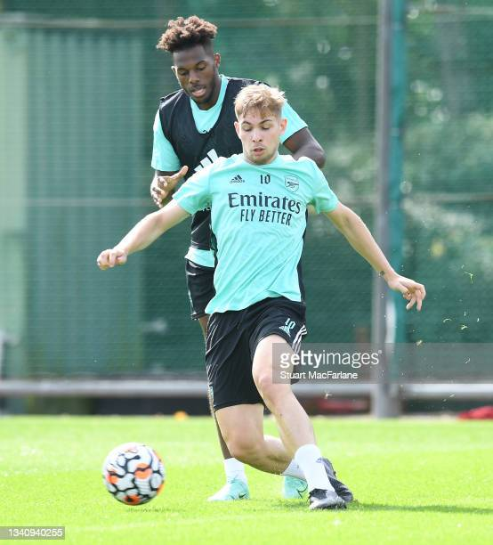 Nuno Tavares and Emile Smith Rowe of Arsenal during a training session at London Colney on September 17, 2021 in St Albans, England.