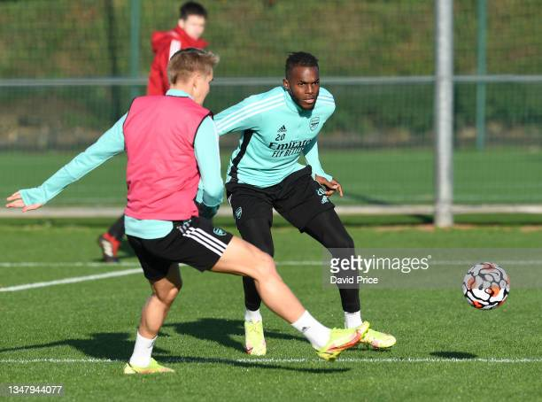 Nuno Tavares and Martin Odegaard of Arsenal during the Arsenal 1st team training session at London Colney on October 21, 2021 in St Albans, England.