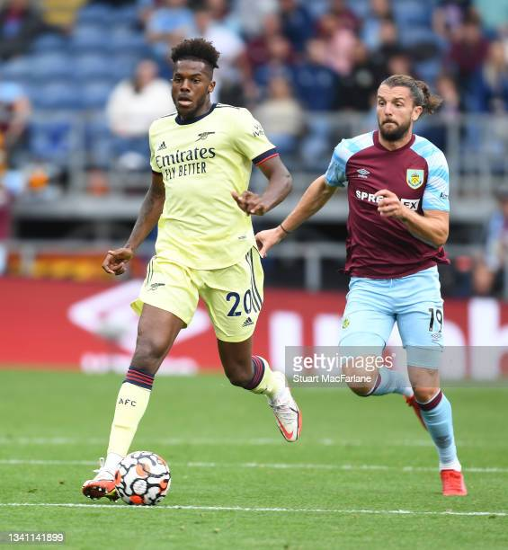 Nuno Tavares of Arsenal breaks past Jay Rodriguez of Burnley during the Premier League match between Burnley and Arsenal at Turf Moor on September...