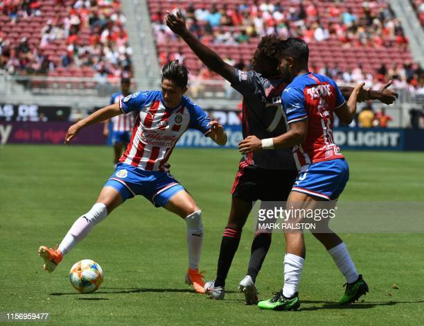 Nuno Tavares of Benfica clashes with Alan Cervantes of Chivas de Guadalajara during their 2019 International Champions Cup match at the Levi's...