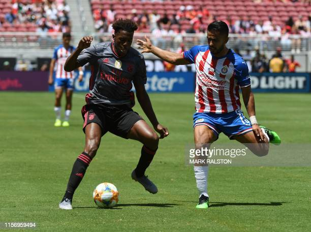 Nuno Tavares of Benfica clashes with Pocho Ponce of Chivas de Guadalajara during their 2019 International Champions Cup match at the Levi's Stadium...