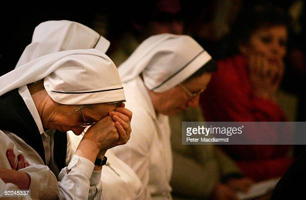 Nuns and patients wait for a special prayer service for Pope John Paul II to begin in the chapel of the Gemelli hospital February 26, 2005 in Rome,...