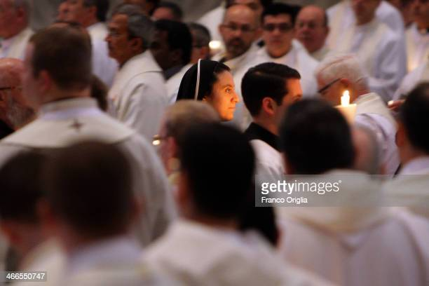 Nuns and priests arrive in procession at St Peter's Basilica for the Candelora Light Ceremony on February 2 2014 in Vatican City Vatican Pope Francis...