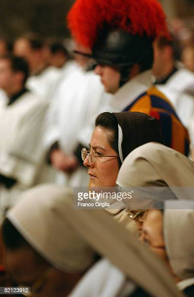 Nuns and priests attend a Mass while Pope John Paul II is hospitalized during the Solemnity of the Presentation of Christ and the Day of Consecrated...