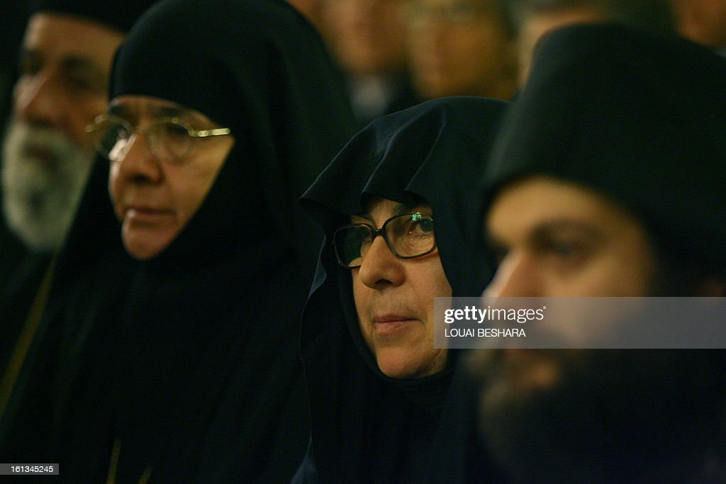 Nuns and priests attend the enthronement of Greek Orthodox leader Yuhanna X Yazigi as the Greek Orthodox Patriarch of Antioch and All the East at the Holy Cross Church, in the Qasaa district of Damascus, on February 10, 2013. Yuhanna X Yazigi was chosen as the Patriarch of Antioch and All the East on December 17, replacing Ignatius IV Hazim who died that month. Christians make up about five percent of the population in Syria, where rebels and forces loyal to Syrian President Bashar al-Assad have been locked in a civil war the UN says has killed more than 60,000 people.