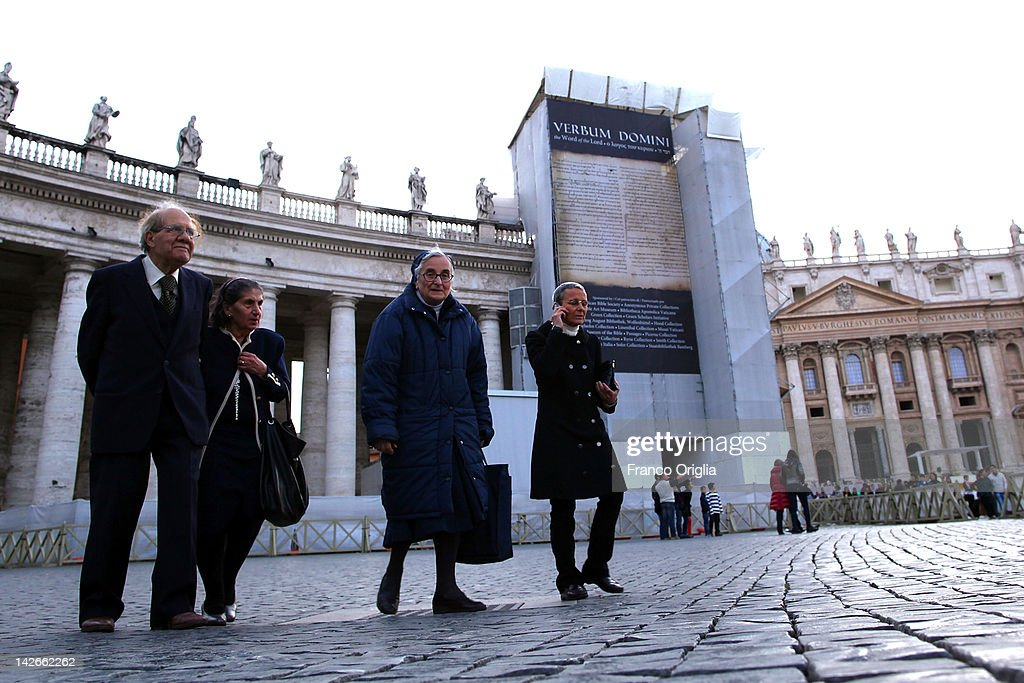 Nuns and priests stand in front of the restoration works of the colonnade of Gian Lorenzo Bernini in St. Peter's Square on April 10, 2012 in Vatican City, Vatican. The square was designed by architect Gian Lorenzo Bernini in 1656. The two semi-circles of the colonnade are surrounded by 140 statues and 244 columns. Guy Devreux of the Vatican Laboratory for Marble and Cast began direction of the works in 2009.