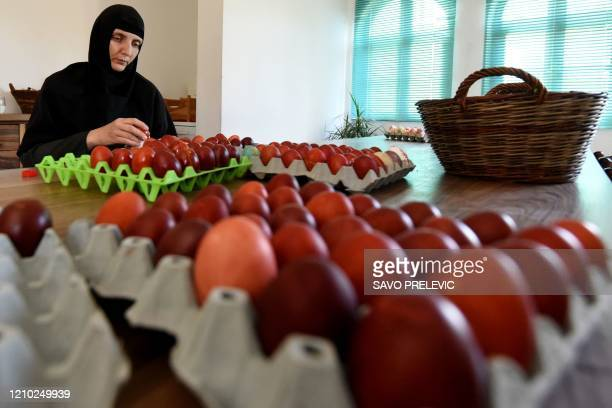 Nuns arranges coloured Easter eggs at a womens Orthodox monastery near Danilovgrad west of capital Podgorica, on April 17, 2020. - For the Orthodox...