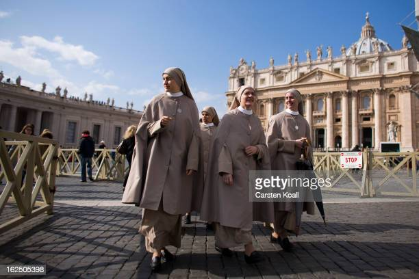 Nuns arrive in Peters Square on February 24 2013 in Vatican City Vatican Pope Benedict XVI delivers his last Angelus Blessing from the window of his...