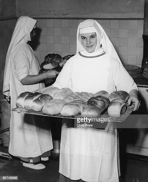 Nuns at Ladywell Convent in Godalming, Surrey, bake a batch of fresh loaves, 28th August 1962. All the Sisters acquire practical skills at the...