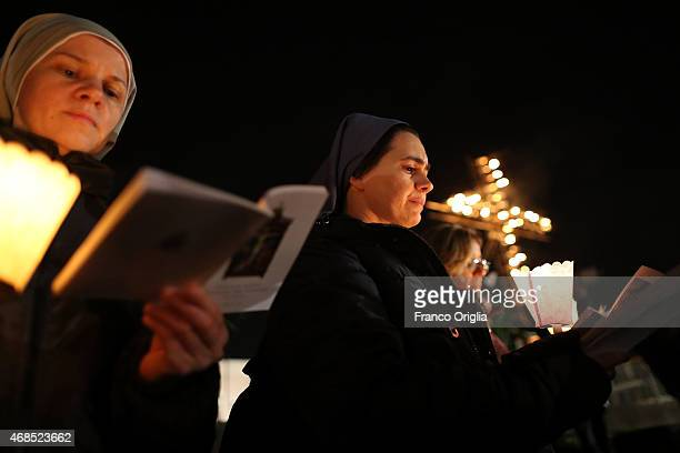 Nuns attend the Way of The Cross at the Colosseum celebrated by Pope Francis on April 3 2015 in Rome Italy The Way of the Cross is a centuriesold and...