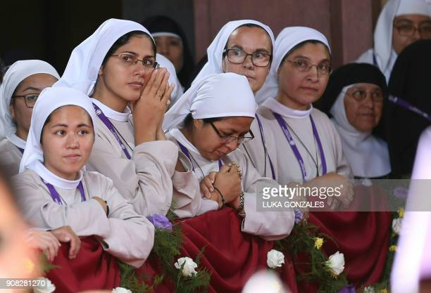 Nuns await for the arrival of Pope Francis inside the Senor de los Milagros Sanctuary where he is set to hold a private meeting with contemplative...
