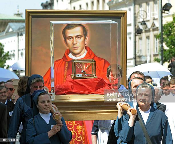 Nuns carry relics of Jerzy Popieluszko in front of his portrait on June 6 in Warsaw in a procession after a beatification mass of Jerzy Popieluszko a...