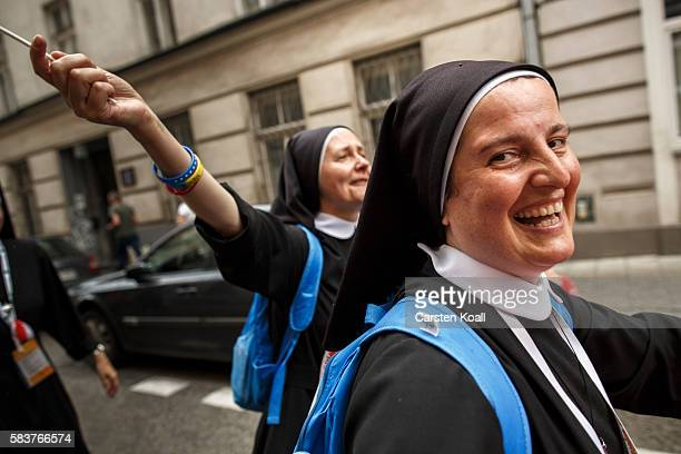 Nuns celebrate after they have seen the passing Pope Francis on July 27 2016 in Krakow Poland Almost two million young people are expected to attend...