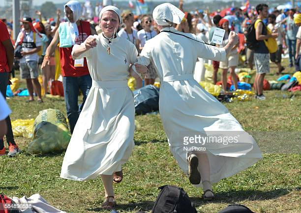 Nuns celebrate the end of the World Youth Day as Pope Francis finishes the Mass in Brzegi near Krakow On Sunday 31 July 2016 in Brzegi Krakow Poland