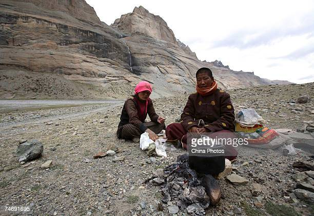 Nuns cook food at Kangrinboqe Mountain known as Mt Kailash in the West where they have come to pray June 15 2007 in Purang County of Tibet Autonomous...