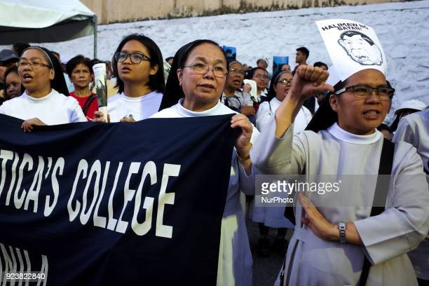 Nuns from St Scholastica's College an allfemale Catholic school participate in a protest ahead of the 32nd anniversary of the EDSA People Power...