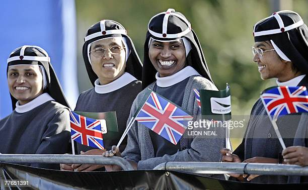 Nuns from the Bridgettine Convent in Fulmer wait for the arrival of Britain's Queen Elizabeth II and Prince Phillip at Pinewood Studios to officially...