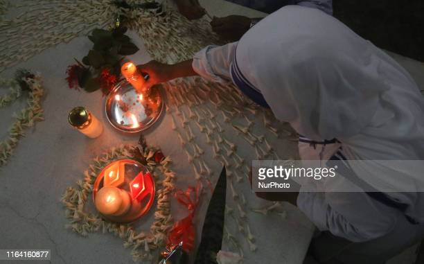 Nuns from the Catholic Order of the Missionaries of Charity and Common peapuls pray at the tomb of Mother Teresa to mark her 109th birth anniversary...