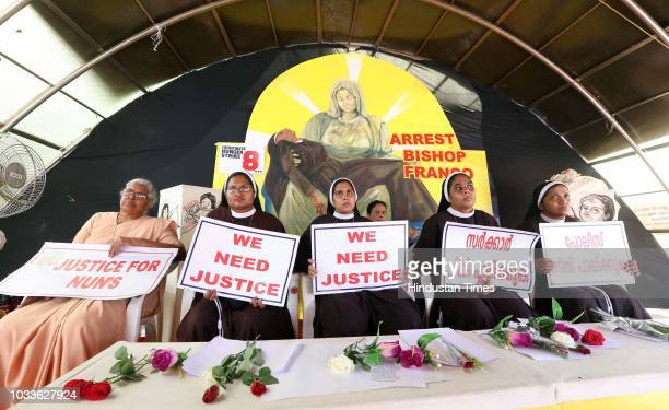 Nuns hold placards during a protest demanding justice after an alleged sexual assault of a nun by a bishop on September 15 2018 in Kochi Kerala...