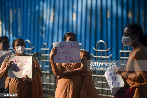 Nuns hold placards during a protest to condemn the alleged gangrape and murder of a 19yearold woman in Bool Garhi village of Uttar Pradesh state in...