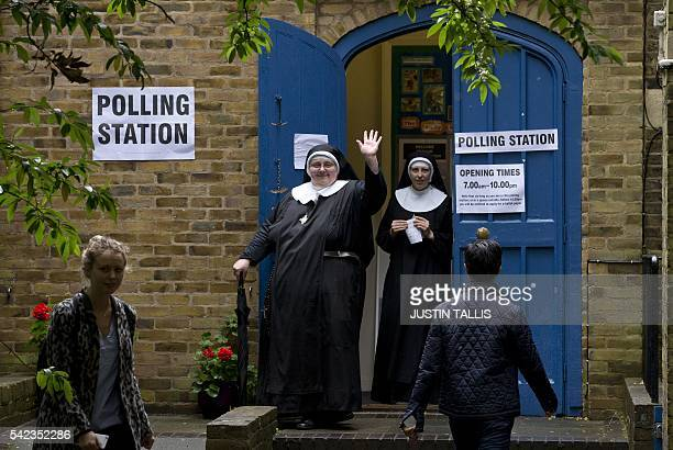 Nuns leave after casting their votes at a polling station in London on June 23 as Britain holds a referendum on whether to stay or leave the European...